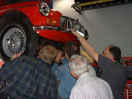 People under the nose of an MGB