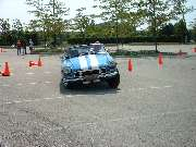 blue MGB running the cones